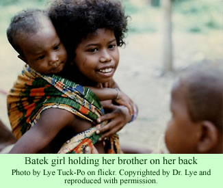 Batek girl and her brother